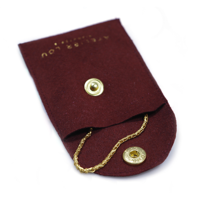 Envelope suede jewelry bag with button close stamping logo